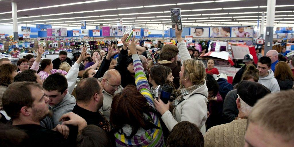 Shoppers vie for copies of video games at a Black Friday sale at a Wal-Mart Stores Inc. store in Mentor, Ohio, U.S., on Thursday, Nov. 24, 2011. Retailers are pouring on the discounts to attract consumers grappling with 9 percent unemployment and a slower U.S. economic expansion than previously estimated. Photographer: Daniel Acker/Bloomberg via Getty Images